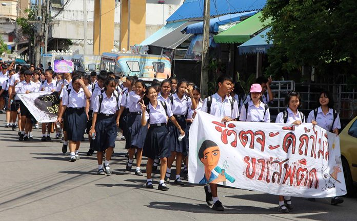 Local students join more than 3,000 Pattaya-area residents in a march against drugs for International Day Against Drug Abuse and Illicit Trafficking.