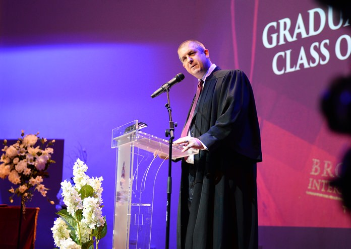 Head Master Dr. Daniel Moore addresses the new graduates on this special day.