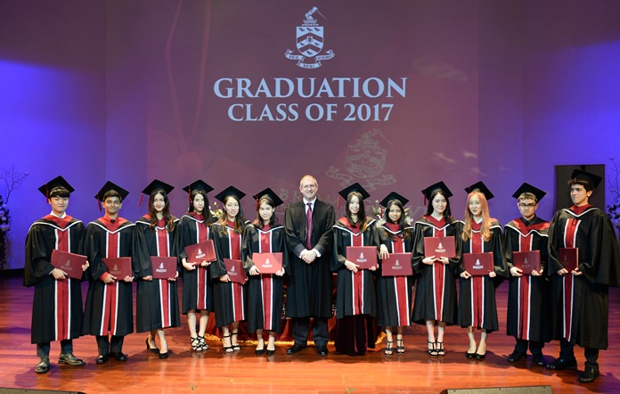 Head Master Dr. Daniel Moore poses with the Class of 2017 after presenting them with their diplomas.