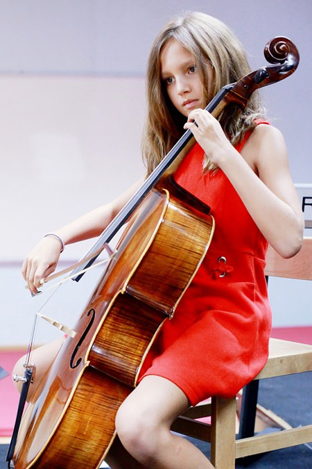 A gifted cello player performed at the GIS Primary Recital.
