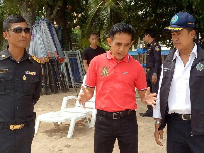 Pattaya officials inspected Jomtien Beach with an eye toward unifying the look of all beach umbrellas.