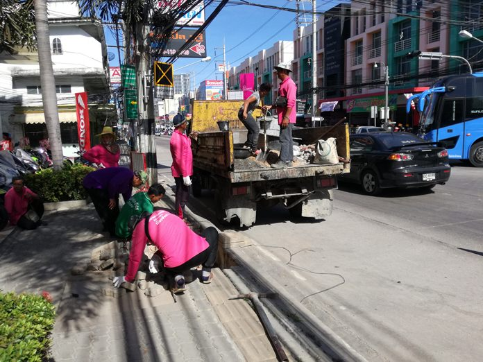 Pattaya workers fill potholes and repair broken tiles in a patch-up job on Thepprasit Soi 7.