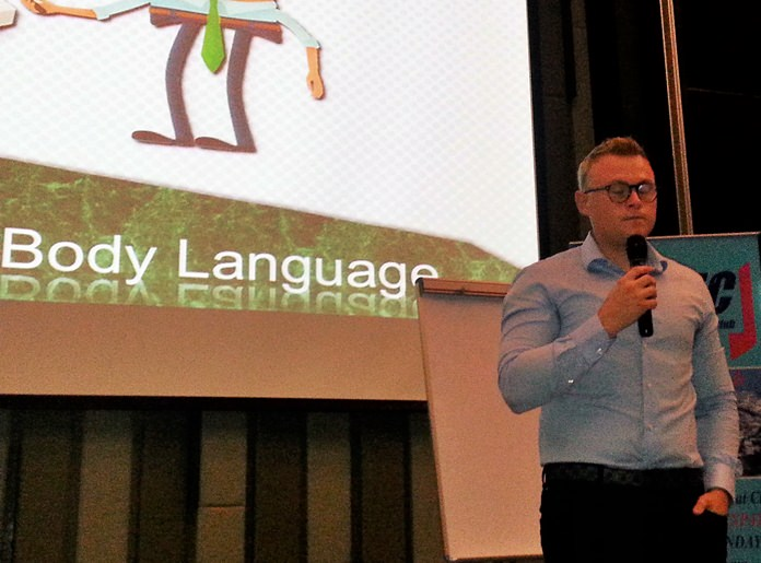 """Jakob Friis posed three questions to his PCEC audience to introduce his topic, """"Secrets of Body Language"""". They were: What exactly is body language? How do you analyze body language and how can we use body language to our advantage?"""
