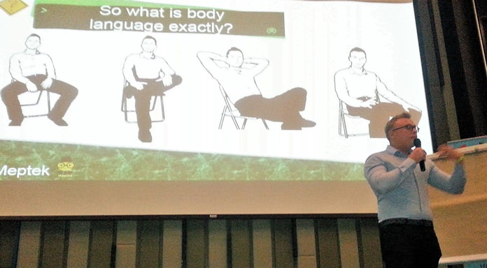 Jakob shows a slide of four body positions; he then described for his PCEC audience how to interpret each of the positions.