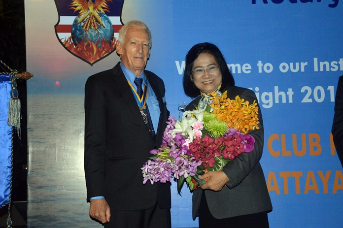 President Peter Schlegel presents DG Onanong with a bouquet of flowers.
