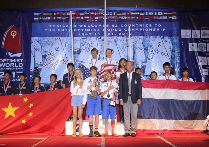 Team USA members (centre) pose on the podium with Admiral Kraisorn Chansuvanich, President of Yacht Racing Association of Thailand, and team members from Thailand (right) and China (left) during the trophy presentations for the Optimist World Championship 2017 at the Grand Heritage Hotel in Pattaya, Thursday, July 20.