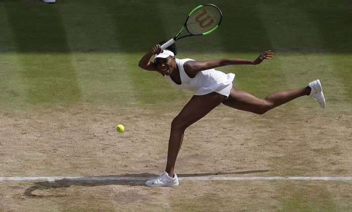 Venus Williams of the United States returns to Britain's Johanna Konta during their women's singles semifinal match on day nine at the Wimbledon Tennis Championships in London Thursday, July 13. (AP Photo/Alastair Grant)