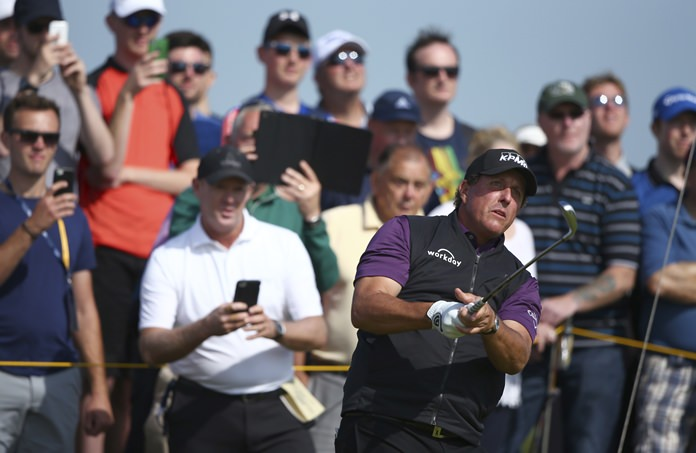 Phil Mickelson of the United States watches his shot from 9th tee the during a practice round ahead of the British Open Golf Championship, at Royal Birkdale, Southport, England Tuesday, July 18. (AP Photo/Dave Thompson)