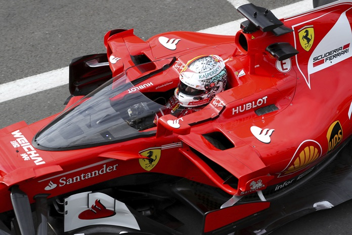 Ferrari driver Sebastian Vettel of Germany tried out the F1 shield at Silverstone but didn't like it. (AP Photo/David Davies)