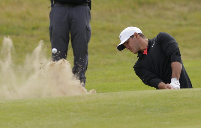 Brooks Koepka of the United States plays out of a bunker on the 18th hole during the first round of the British Open Golf Championship at Royal Birkdale in Southport, England Thursday, July 20. (AP Photo/Alastair Grant)