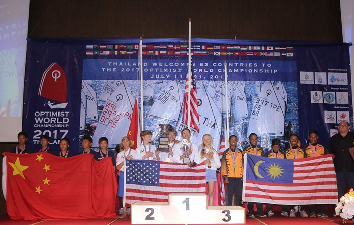 Team USA, centre, celebrates on the podium with second placed Team China, left, and Team Malaysia, right, during the awards ceremony for the Optimist World Championship 2017 held at the Grand Heritage Hotel in Pattaya, Thursday, July 20.