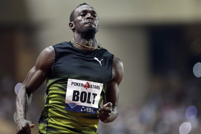 Jamaica's Usain Bolt crosses the finish line first in the men's 100m race at the IAAF Diamond League Athletics meeting at the Louis II Stadium in Monaco, Friday, July 21. (AP Photo/Claude Paris)