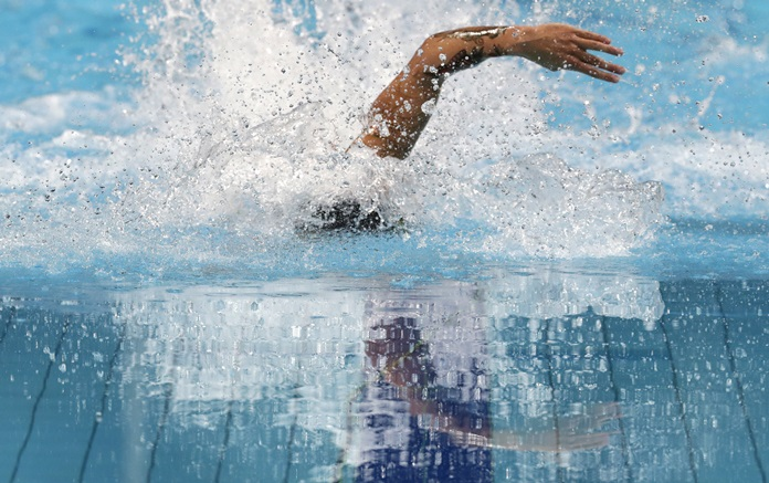 United States' Caeleb Remel Dressel competes in the 4x100-meter freestyle mixed relay final during the swimming competitions of the World Aquatics Championships in Budapest, Hungary, Saturday, July 29. (AP Photo/Michael Sohn)