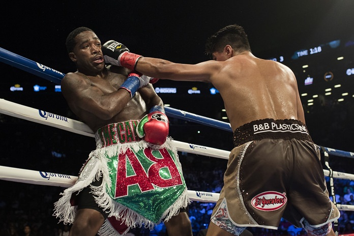 Mikey Garcia, right, hits Adrien Broner during their boxing bout Saturday, July 29, in New York. (AP Photo/Andres Kudacki)
