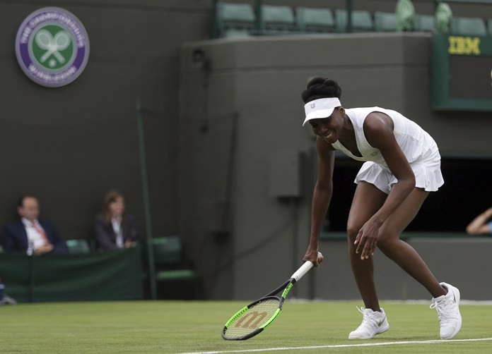 Venus Williams of the United States reacts during her Women's Singles match against Belgium's Elise Mertens on the opening day at the Wimbledon Tennis Championships in London Monday, July 3. (AP Photo/Tim Ireland)