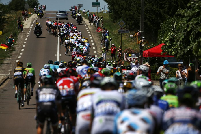 The peleton rides during the sixth stage of the Tour de France cycling race over 216 kilometers from Vesoul to Troyes, France, Thursday, July 6. (AP Photo/Peter Dejong)