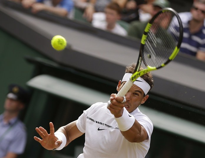 Spain's Rafael Nadal returns to Russia's Karen Khachanov during their Men's Singles match on day five at the Wimbledon Tennis Championships in London Friday, July 7. (AP Photo/Alastair Grant)