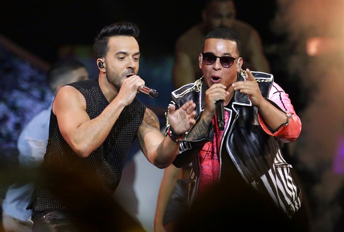 In this April 27, 2017 file photo, singers Luis Fonsi, left and Daddy Yankee perform during the Latin Billboard Awards in Coral Gables, Fla. On Friday, Aug. 4, 2017.(AP Photo/Lynne Sladky, File)
