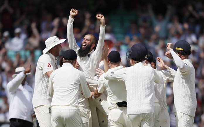 England's Moeen Ali is lifted by his team mates after he takes a hat trick on the fifth day of the third test match between England and South Africa at The Oval cricket ground in London, Monday, July 31. (AP Photo/Kirsty Wigglesworth)