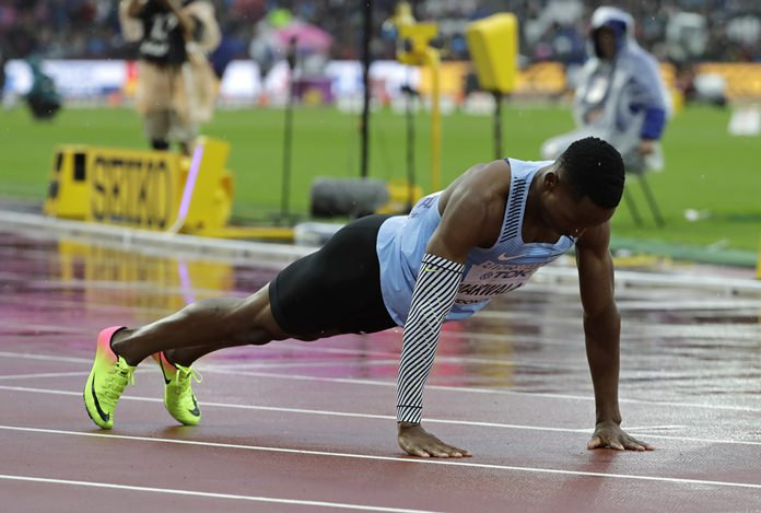 Botswana's Isaac Makwala does press-ups on the track after finishing a Men's 200m individual time trial during the World Athletics Championships in London Wednesday, Aug. 9. (AP Photo/David J. Phillip)
