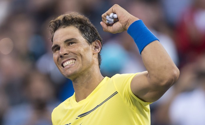 Rafael Nadal of Spain celebrates his victory over Borna Coric of Croatia during the Rogers Cup men's tennis tournament, Wednesday, Aug. 9, in Montreal. (Paul Chiasson/The Canadian Press via AP)