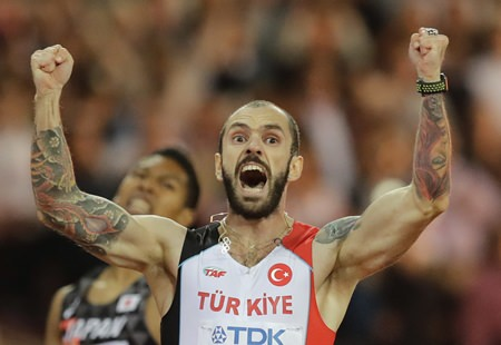 Turkey's Ramil Guliyev celebrates as he crosses the line to win gold in the men's 200-meter final during the World Athletics Championships in London Thursday, Aug. 10. (AP Photo/Tim Ireland)