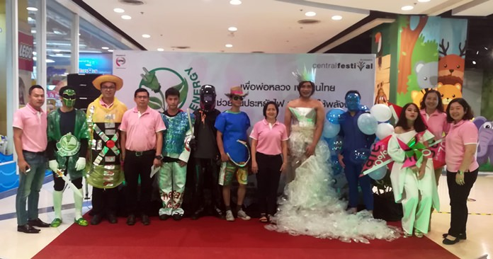 Employees show off efforts they've made to save energy with exhibits, games and a fashion show with dresses made of recycled materials.