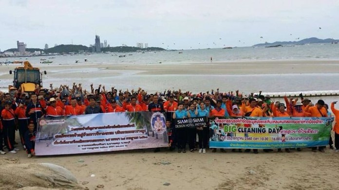 Sailors and residents joined to pick up garbage and other debris from Pattaya Beach for HM the King's birthday.