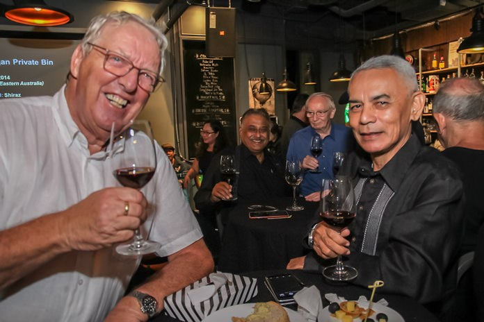 Helge Holst and Capt. Sitthichoke Adinan enjoying the excellent wines.