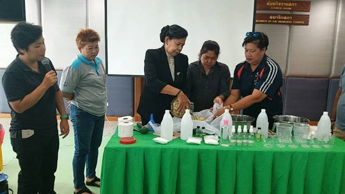 Nongprue residents are taught the benefits of lemongrass in repelling mosquitos.