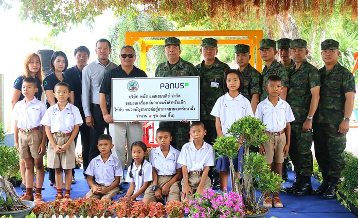 Rear Adm. Ekaraj Poromlampak accepts the donation of five sets of playground gear from Panas Assembly Co. representative Somsak Nonpho.