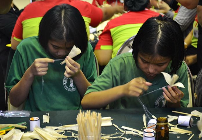 The blind students making daffodils.