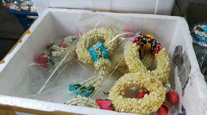 Readymade garlands were selling for 250 baht, five times the normal price.
