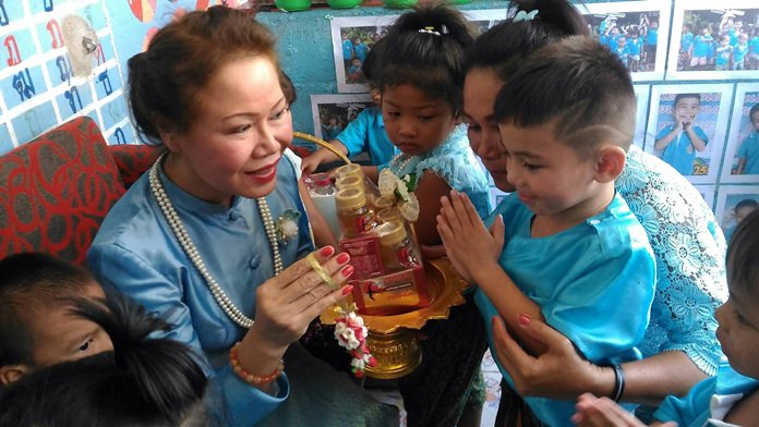Children lovingly say thank you to their mothers and grandmothers on Mother's Day in the Soi Kophai Community. Thousands of residents flocked to government ceremonies and Eastern Seaboard shorelines on Mother's Day to celebrate motherhood, make merit and replenish the environment for HM Queen Sirikit's 85th birthday.