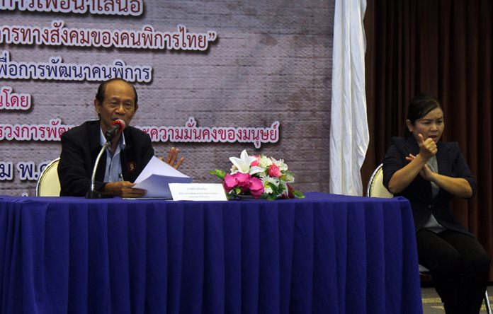 Pinit Sujinphrom, advisor to the Association for the Mentality Ill of Thailand, hosts the eminar at the Redemptorist Vocational School for Persons with Disabilities.