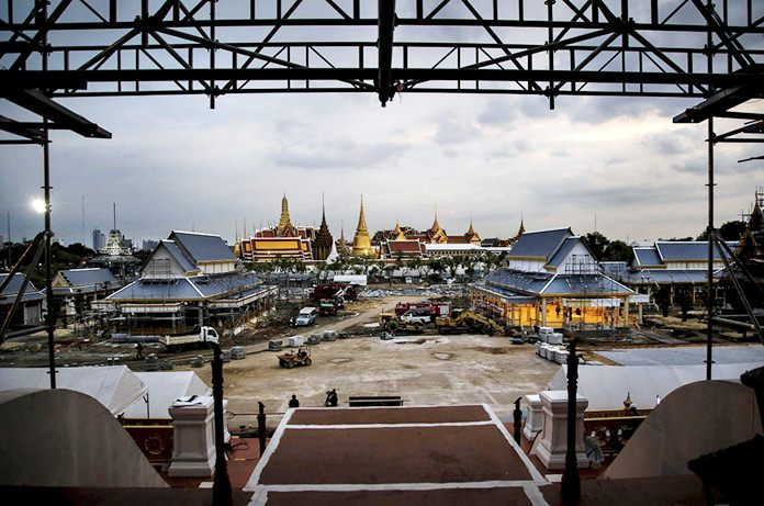 The scaffolding from the top floor of the royal crematorium, located in Sanam Luang, frames the Temple of Emerald Buddha in Bangkok.