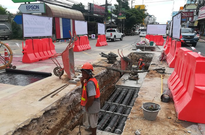 The Provincial Electricity Authority has decided to work around the clock on weekdays moving power and utility lines below ground on Central Road to speed the project's completion.