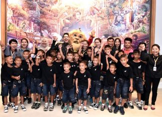 Children pose for a photo after enjoying the fabulous Kaan show at the Singha D'Luck Cinematic Theatre in Pattaya, August 9.