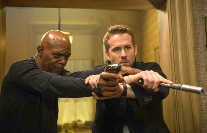 "This image shows Samuel L. Jackson (left) and Ryan Reynolds in ""The Hitman's Bodyguard."" (Jack English/Lionsgate via AP)"