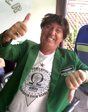 Wayne Peppernell dons the green jacket and the wig.