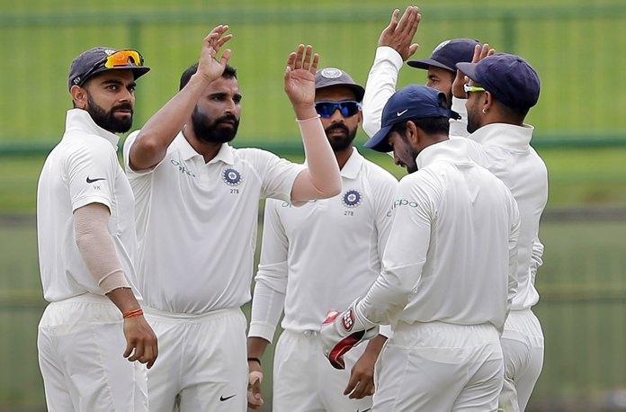 India's Mohammed Shami, second left, celebrates with teammates after the dismissal of Sri Lanka's Kusal Mendis during the third day's play of their third cricket test match in Pallekele, Sri Lanka, Monday, Aug. 14. (AP Photo/Eranga Jayawardena)