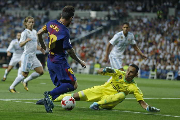 Barcelona's Lionel Messi, left, challenges Real Madrid's goalkeeper Keylor Navas during the Spanish Super Cup second leg match at the Santiago Bernabeu stadium in Madrid, Wednesday, Aug. 16. (AP Photo/Francisco Seco)
