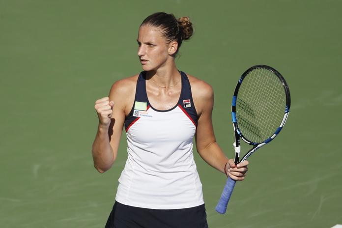 Karolina Pliskova, of the Czech Republic, reacts during a match against Caroline Wozniacki, of Denmark, at the Western & Southern Open tennis tournament, Friday, Aug. 18, in Mason, Ohio. (AP Photo/John Minchillo)