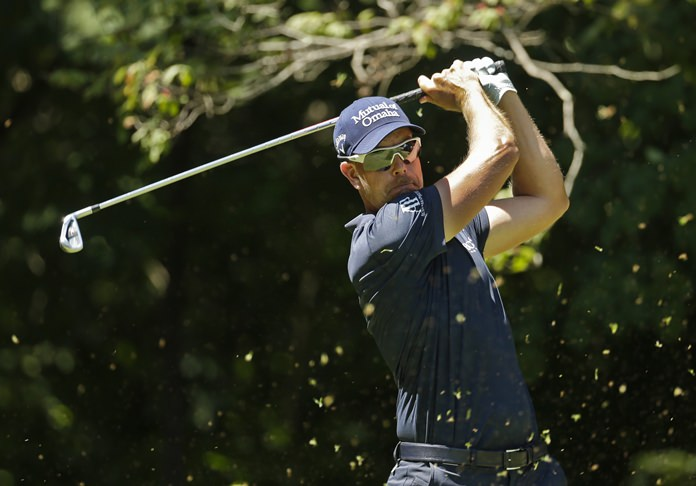 Henrik Stenson watches his tee shot on the second hole during the final round of the Wyndham Championship golf tournament in Greensboro, N.C., Sunday, Aug. 20. (AP Photo/Chuck Burton)