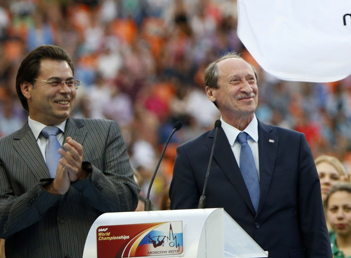 In this Sunday, Aug. 18, 2013 file photo, Russian Athletics Federation President Valentin Balakhnichev, right, and deputy mayor of Moscow Alexander Gorbenkov, left, attend the closing ceremony at the World Athletics Championships in the Luzhniki stadium in Moscow. (AP Photo/Alexander Zemlianichenko)