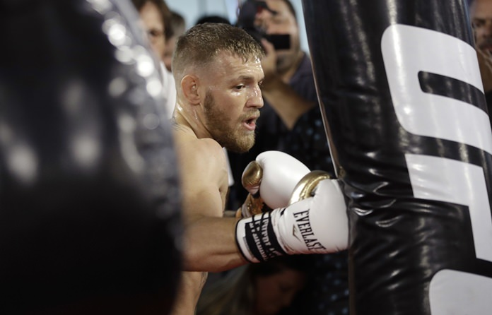 This Aug. 11, 2017, file photo shows Conor McGregor training during a media workout in Las Vegas. (AP Photo/John Locher)