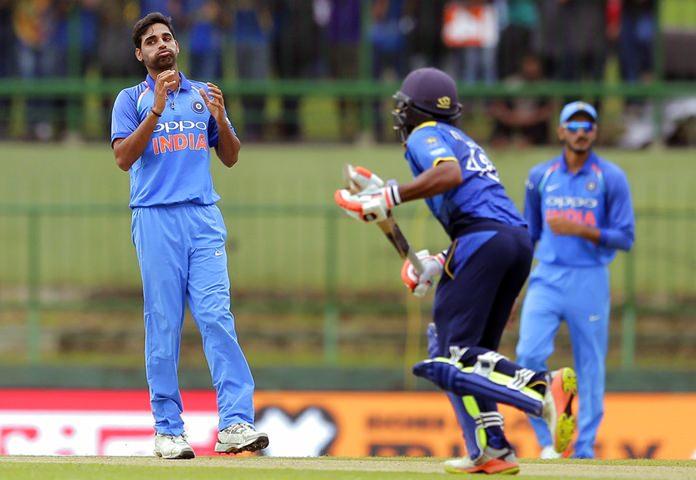 India's Bhuvneshwar Kumar, left, reacts after bowling a delivery to Sri Lanka's Niroshan Dickwella, center, during their second one-day international cricket match in Pallekele, Sri Lanka, Thursday, Aug. 24, 2017. (AP Photo/Eranga Jayawardena)
