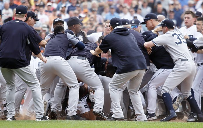 Detroit Tigers and New York Yankees players get involved in a bench-clearing fight during the sixth inning a of their baseball game Thursday, Aug. 24, in Detroit. (AP Photo/Duane Burleson)