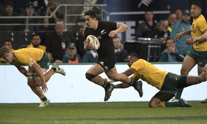New Zealand's Anton Linert-Brown makes a break against Australia during their Bledisloe Cup rugby test in Dunedin, New Zealand, Saturday, Aug. 26. (Brett Phibbs/New Zealand Herald via AP)