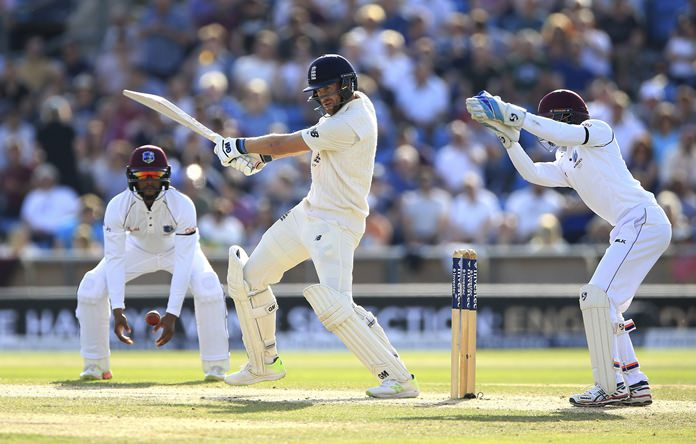 England's Dawid Malan, centre, swings at the ball during day three of the second test match at Headingley in Leeds, England, Sunday Aug. 27. (Nigel French/PA via AP)